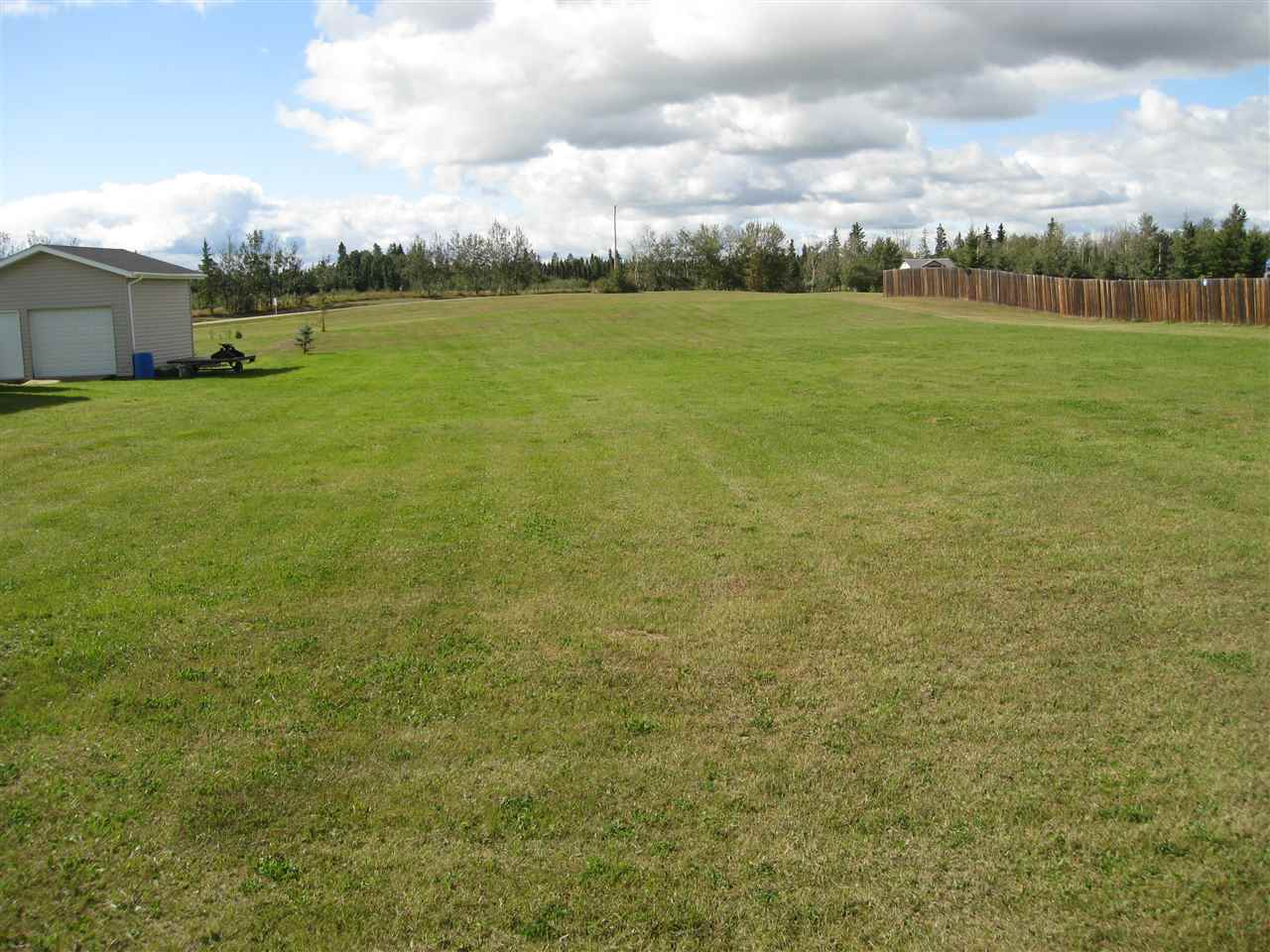 This flat and wide open .6 Acre Lot is located across the road from the Lake Front properties at Sandy Lake. This Lot has a park Reserve in the back so there will not be any neighbours in the back!! Get ready to build your home or retirement Home on this extra Large Lot located only 1/2 hr. from Stony Plain and St. Albert.