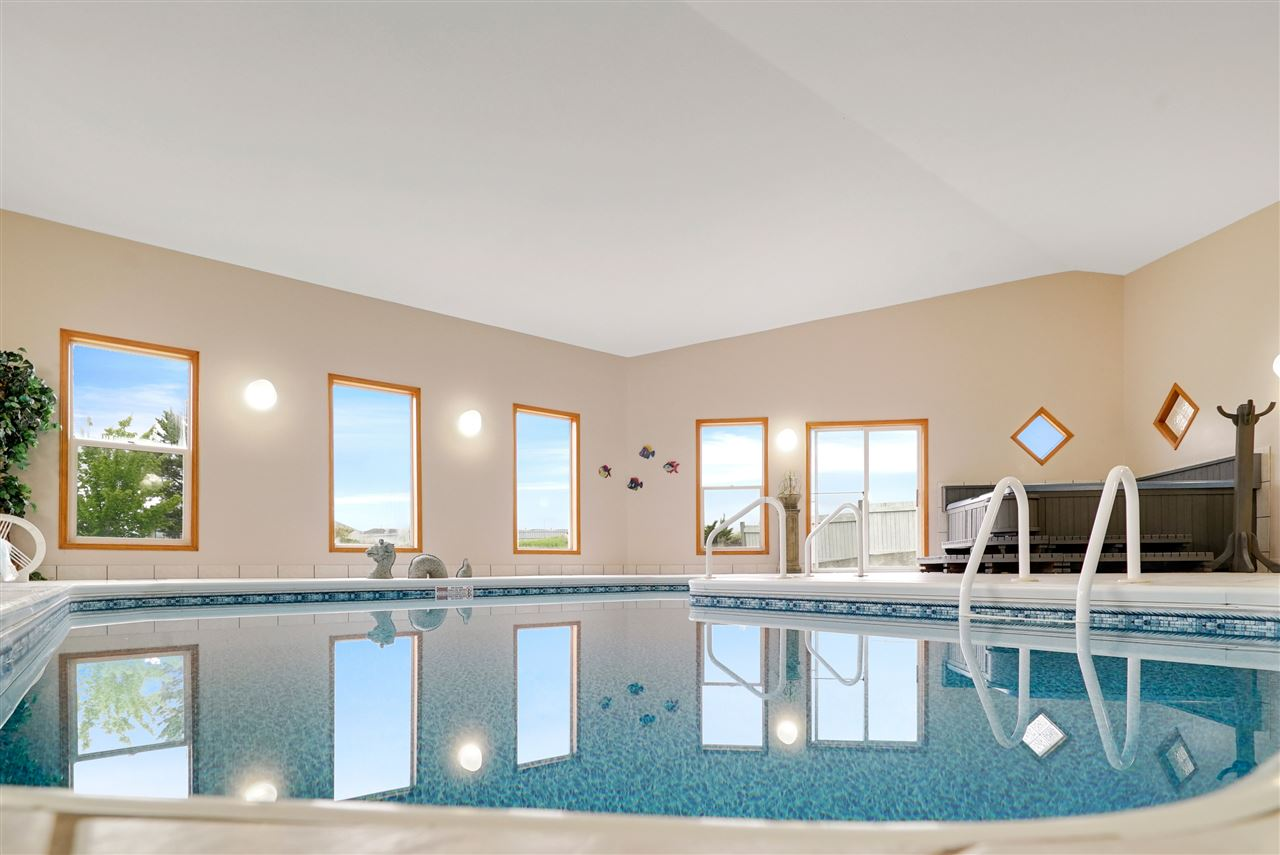 Welcome to Fountain Creek Estates, an amazing executive acreage community in Sherwood Park! This 2-Storey is a very rare gem, a custom build with an intentionally designed low-maintenance indoor pool & hot tub. Great for entertaining, relaxation or aquatic exercise any time of year! Imagine welcoming your friends & family into your new home as they compliment you on the amazing lot size & exclusive location backing the green-belt. Wait until they see the privacy of the upstairs master bedroom with the kids downstairs in the basement! From this location, it's easy to fast-track into Sherwood Park via Sherwood Drive to access all the shopping & restaurants along Wye Road. Plus, it's also quick to get into Edmonton via Whitemud from here! If you love the idea of your older children with their own space downstairs.. If you can't wait to tell your friends & family to bring their bathing suits.. If you love the idea a giant lot with less neighbours & more privacy.. Then this home might be your home!
