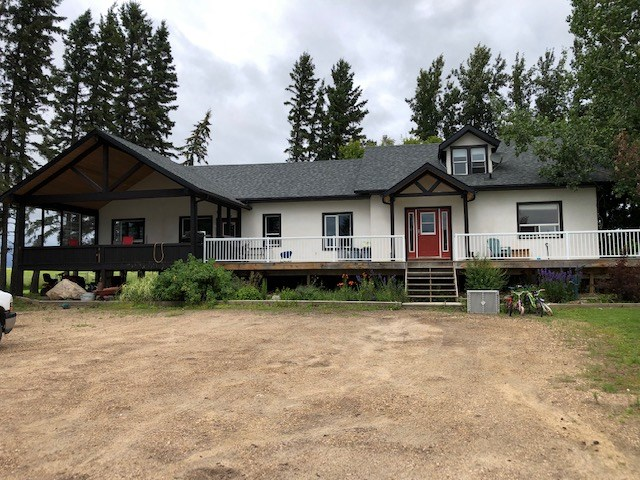 This is a very unique,large and beautiful 4.5 acres with an older home totally redone into a modern,roomy and one of a kind 2310 sq. ft. 5 bedroom home along with a 60 ft deck and a large covered deck , just south of Vega Alberta.  Pavement almost to the driveway and 2 large shops along with a very new hiproof barn which is is 24 by 28 and very new are some of the things that make this a very attractive property for many! There are also some animal pens for someone who likes to enjoy different animals with a few acres of pasture. Currently the large shop is rented by a cabinet business and the proprieters of the business would like to keep renting this for a few years if possible. Please do not hesitate to ask about this as it could help out the new owners with a steady income. One shop is 48 by 56 and the cabinet shop is 50 by 90.Both have 14 ft ceilings.