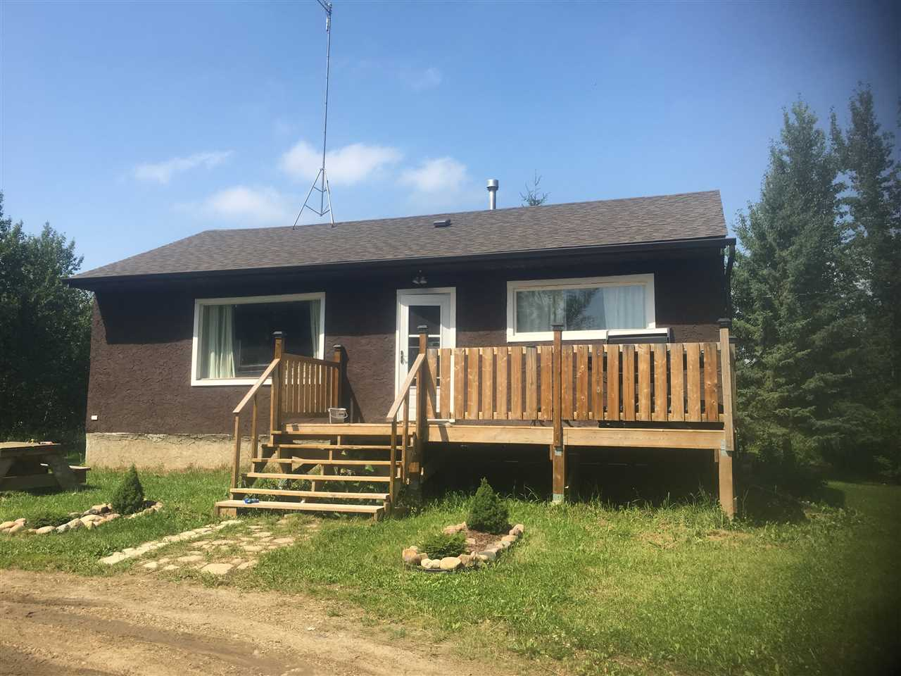 Looking for your own piece of paradise with a good sized house with a full height basement at a super affordable price? Fabulous location minutes to Alberta beach fishing, swimming and boating! This amazing 3.5 acres of mature trees and rolling hills has walking and quad trails throughout, perfect for kids, dogs and horses. Solid family bungalow with new many new vinyl windows and two good sized bedrooms with full basement, deck and shop. Hardwood floors, large kitchen with lots of cabinet space. Brand New Singles, Upgraded electrical to 100 amp service, drilled deep well. Would make a great recreational property for the weekend as well. Open yard surrounded by large trees and fruit bearing trees and shrubs. Next to an Environmental Reserve and neighbouring yard is fenced. Landscaped front yard. Excellent opportunity for hobby farm. Only 5 minutes away from Alberta Beach, 20 minutes from Stony Plain. Features large powered workshop!