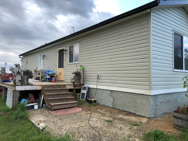4.32 acres of freedom in the county of Westlock about 6 miles west and north of Busby with a 2017 Modular 16 by 52 2 bedroom home on screw piles. lots of room for a few animals, a 24 by 30 tarp shelter about 10 years old, power and water ready for a garage, and much more!