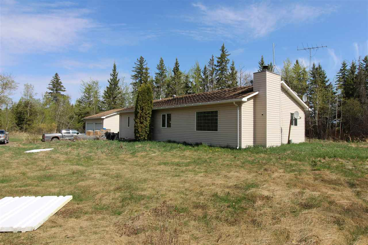 Make this ACREAGE YOURS!. Situated on 2.62 acres with double detached garage (22x28 w/concrete floor) and a NEWER POLE SHED 30x48 (shell) with overhead door. Home features 4 BEDROOMS (no basement). Located just outside the Hamlet of Busby ALONG PAVED HWY 651 (acreage approach off RR 273, only 0.25 km of municipal gravel). LOADS OF POTENTIAL!!