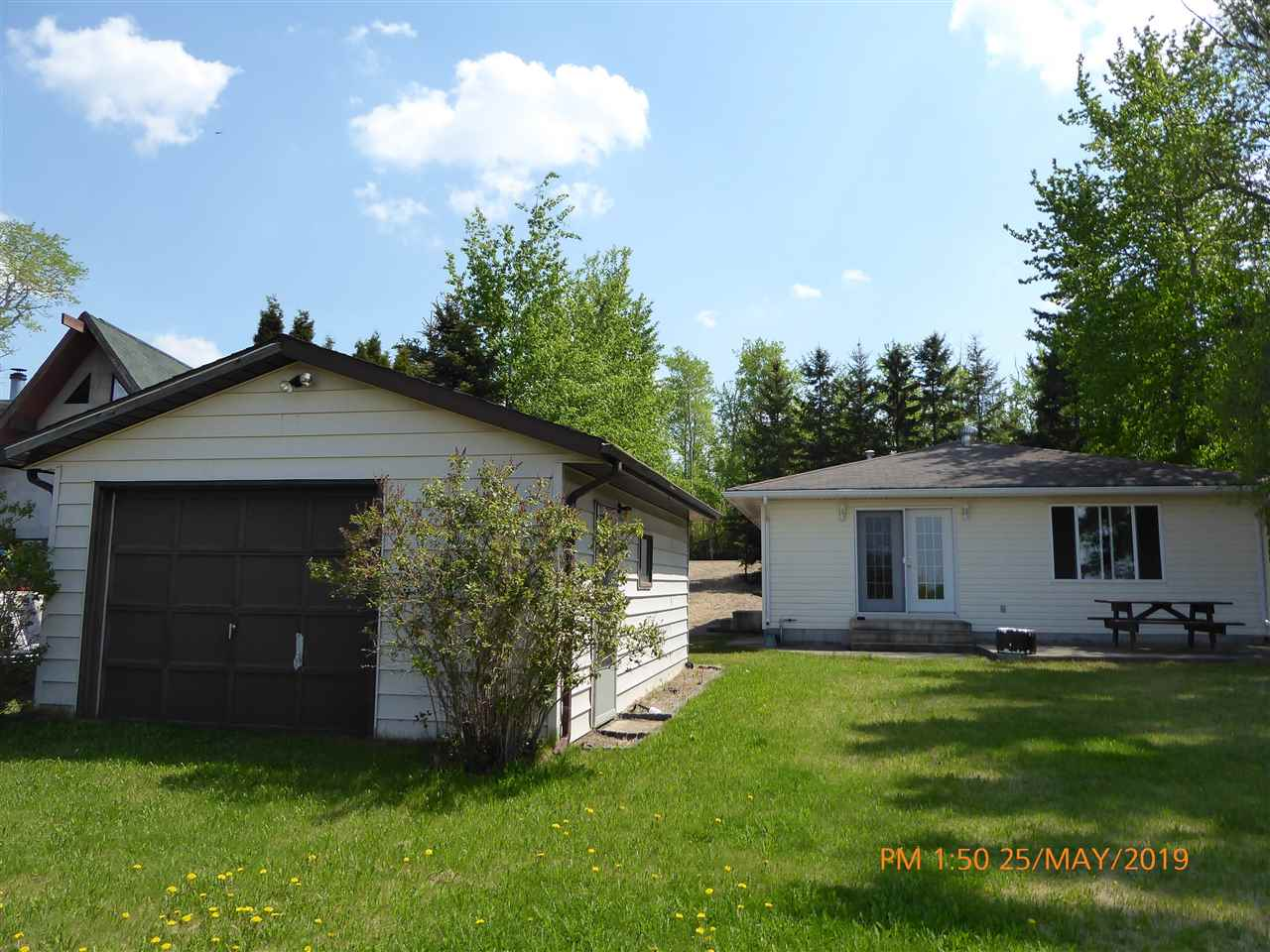 ! **$299,900** - Incredible Value at Hastings Lake! Yes, 'Live at the Lake', out in the Country, where 'the deer and the moose and the pelicans play'. So, at Hastings Lake, a mere 24 paved minutes East of Edmonton and Sherwood Park, there is this immaculate 1078 Sq Ft 3-Bedroom Lakeside Bungalow awaiting new ownership. Built in 1998, this fine Home is Open Concept, with the Ktichen, Dining area and Living Room overlooking lakeside, with garden doors leading out to the patio with a lake view. Comes with 5 appliances and all house furnishings. Outside there is an Oversized Single Garage and a fully landscaped lot.  Ready to enjoy!
