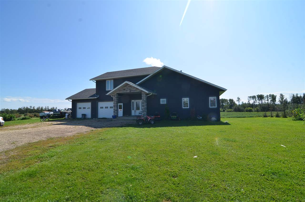 52 acres along the Paddle River located only 3 miles from Barrhead at end of private dead end road. Modern 2014 built Custom Bungalow w/ fully finished walk out bsmnt invites you through the main living areas the minute you walk through the door. Extensive quality Kitchen cabinetry w/ large Central sitting island, Granite counter tops, SS appliances & more. Bright & airy High vaulted ceilings continue through dining & living over top of hardwood floors. Full length south facing upper entertainment deck features large hot tub & south facing views to the River. Large main floor master bdrm w/ spacious luxury master ensuite & custom tiled shower. Bsmnt features high end centralized stone faced fireplace, large family & recreation space plus full wet bar & doors to walk out patio option. Large laundry, 2 large bdrms & large bath. 4th bdrm & office in bonus space above double car heated & attached garage. Absolute must  w/ Privacy, River land & Modern living space only minutes from town convenience.