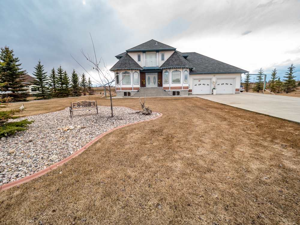 Exceptional almost 3500 sq ft custom and well kept H&S Jones built 2-storey close to Sherwood Park in the upscale Ranchlands community. Gorgeous hardwood floor and tile work showcase a dramatic split staircase, granite countertops, sculpted ceilings, huge master bedroom with balcony and 5 pc ensuite. Bonus room with 2nd gas fireplace, guest bedroom/bathroom with separate entry. Basement boasts huge wet bar and entertainment area. Heated 4 car garage, huge shop, fully landscaped. Move in and enjoy!