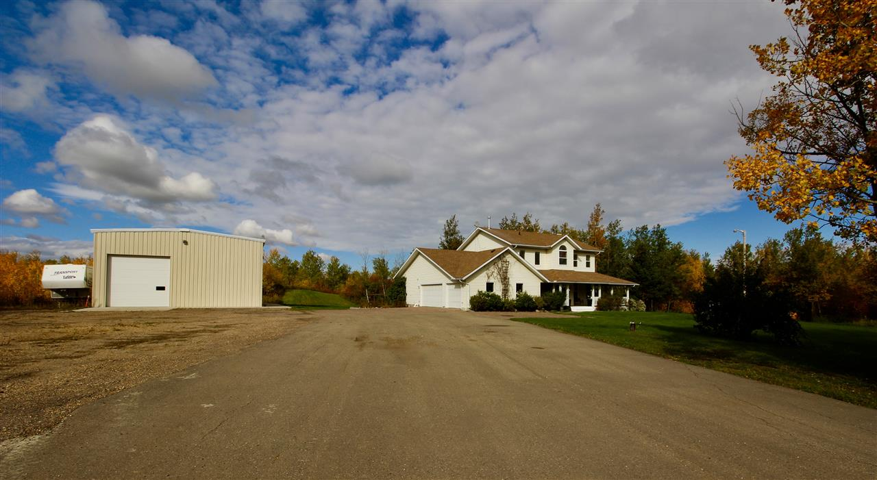 """NEW 40X60 steel framed insulated&powered SHOP with climate controlled radiant heating,engineered 6""""concrete floor,20 ft ceilings,2-16 ft doors.A short scenic drive from Sherwood Park to RR210 just off the Yellowhead is this 20 acres of private OASIS across from Elk Island Park. This 3100+sq ft executive home is surrounded by nature featuring a pond, trials, trees, huge yard, etc.has much to offer.Open concept main floor living space with an abundance of large bright NEW windows.Featuring an updated kitchen with granite counter tops and lots of white cupboards, dining nook with French door to deck,LR with wood fireplace, formal DR,Flexroom,2pc bath and separate mud/laundry room adjoining to a 3pc bath.Upstairs is the master suite with vaulted ceilings,reno'd spa like ensuite, 3 more spacious bdrms, bonus room and full bathroom.Other features include infloor 5zone boiler heating system,an iron eater,new shingles,Intricate stone walks,decked in hot tub,large patio & fire pit.105 ft well and pump-out septic."""