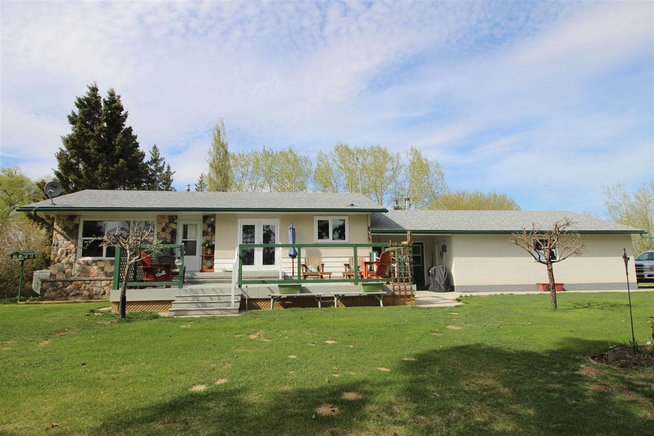 LOCATION, LOCATION, LOCATION, less than ten minutes north of Westlock and just off pavement.  2.00 acres beautifully landscaped w/ well maintained 1322 sq ft 2+1 bdrm bungalow & attached garage.  Enter home through spacious enclosed breezeway to main floor laundry which has counter & sink as well as room for deep freeze.  U shaped kitchen w/dining area & door to front deck, bright south facing living room w/laminate flooring throughout.  Down the hall is 2 bedrooms & 4 pce bath.  Finished basement with bedroom, family room, craft room, mechanical/storage room & 3 pce bath.  The finsihed attached garage is 28x28 and heated.  Home has had many upgrades including shingles, windows, soffit, facia, & metal window capping, flooring, paint, drilled well, etc.  Outside enjoy the huge south deck with pretty view of mature landscaped yard, fire pit area, flower beds, etc.  There is a older greenhouse w/gas & a tarp shelter for toy/equipment storage.