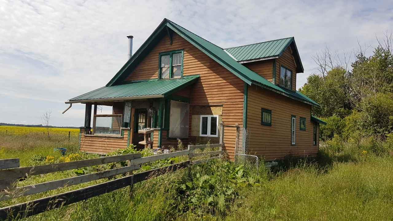 GREAT ACREAGE LOOKING FOR NEW OWNERS. AMAZING LOCATION.....CLOSE TO ST ALBERT, LEGAL, WESTLOCK AND 3 MILES TO HALF MOON LAKE. JUST OVER 4 ACRES, 2 STOREY 3 BEDROOM/2 BATH, NUMEROUS OUT BUILDINGS. MATURE TREED LOT. GREAT FOR WEEKEND RETREATS OR REMODEL AND MAKE IT YOUR PERMANENT HOME. 2 MILES TO LILLY LAKE HI WAY ( PAVEMENT ) .