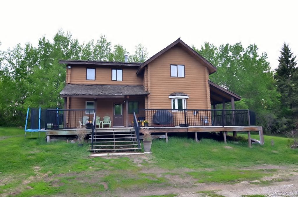 6 acres only 2 miles from Lac La Nonne Lake conveniently located just off the pavement quietly tucked away surrounded by trees & open meadow. This classic Log home features all the character you could hope for in your year round home or summer retreat. Grand 2 story vaulted ceilings welcome you into the large main living area spacious enough for you to spend countless hours enjoying your winter days & summer nights. Open views from living area to kitchen & dining room which most prominently provides excellent unobstructed space around the cabinets & dining table. 3 good sized Bedrooms can be found on the 2 main levels w/ options for a 4th along w/ a good 2nd family room in the undeveloped basement. 4 pc Main floor Bath has been tastefully updated while the upper Bath features recently installed antique claw foot tub & useful extra wide vanity. Plenty of private outdoor space. Wrap around open & covered deck. Fenced meadow & pasture area if so desired. Extra room for your choice of outbuildings & more.