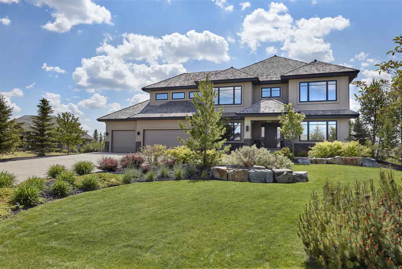 Riverstone Pointe - Modern Family Dream home!  This stunning 2 storey home has over 6457sqft of living space-6 beds,7 baths, triple car garage (1123sq ft) ,walkout basement,sport court & more-all situated on a 0.52 acre mature landscaped lot with sweeping views of the river valley. Clean lines & Custom finishings throughout the home on all 3 levels. This home encompasses?a formal dining room, private office, wine area, fabulous chef?s kitchen with SUB ZERO & WOLF appliances, walkthrough pantry, boot room, dinette area, living room with fireplace & spacious balcony with fireplace & incredible views! Upstairs?the master suite has a private balcony, dressing room & spa like ensuite. Beds #2,#3, #4 are all a great size with their own private ensuites. The private gym & laundry room complete the 2nd level. The walkout basement has over 2000sqft of developed space - custom bar, family room, games area, 2 beds, ½ bath & jack/jill bath. Outside?mature landscaping completes this amazing backyard with sport court!