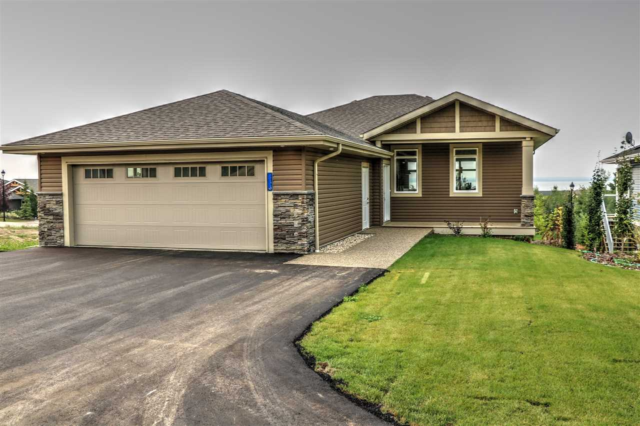 """This Lake View Lot comes with a Brand New """"Larch"""". Preselling this 1434 Sq Ft Bungalow. HUGE Open concept kitchen that makes way to the living room. The living room with gas f/p flows out to a large lake-facing covered deck. The main floor is host to the Master suite, powder room, laundry room and 2nd bedroom. This home is being Sold at Drywall stage so that its ready for you to take over and finish to your taste, or developer can finish for you! If you want more space, the basement is ready for a family room with bar, 2 more bedrooms and an additional 4 piece bathroom. Located in a gated (not age restricted) community. Did I mention the Oversized attached 25.5x23 garage. Picture shown is that of a representation of a Completed """"Larch"""" and not on this property.  This community offers amenities such as a private marina, clubhouse, fitness centre, hiking, beach volleyball, and a gorgeous waterfront outdoor pool. Includes Landscaping! Easy commute to the city!"""