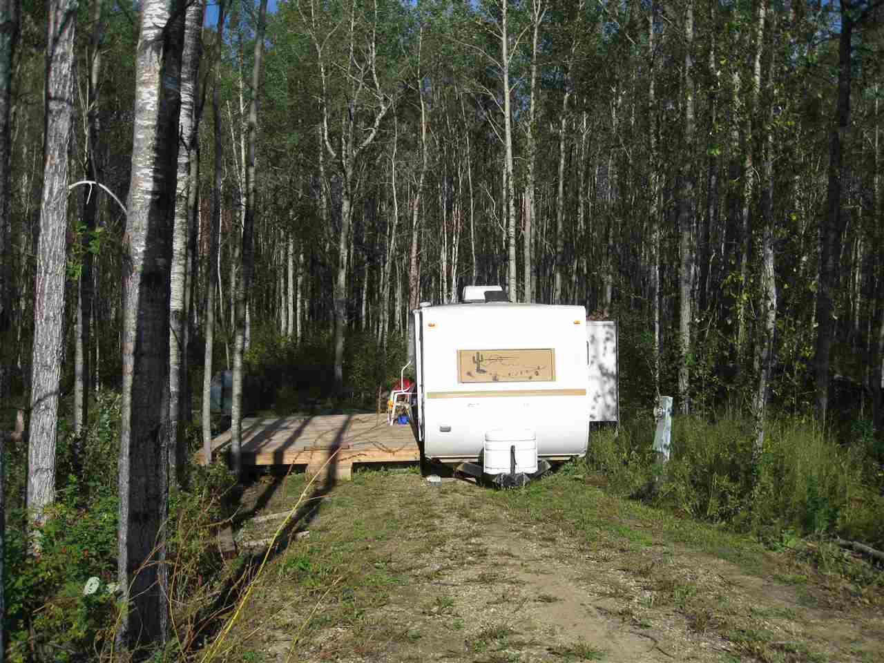This great RV lot is located in a quiet cul-de-sac at the Lake Arnault RV Resort only 50 minutes west of Spruce Grove. Comes complete with a 2005 Conquest Gulfstream Travel Trailer that sleeps 6. The property has Water, Power , 750 Gallon Holding Tank and Garbage Disposal. This is a Great getaway property and also comes with a Canoe & Oars ,BBQ and Deck. There is an Annual Condo fee of only 1300.00. The Unit number is 66. Get ready to enjoy the fall with this serviced Lot and RV!!