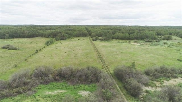 VERY SCENIC & PRIVATE 46 ACRE PARCEL JUST 1 MILE NORTH OF THE YELLOWHEAD AND 1 MILE WEST TO ELK ISLAND PARK FEATURING A GOOD MIX OF HAYLAND AND TREES. THERE IS ALREADY A ROAD TO THE BACK OF THE PROPERTY TO AN ABANDONED WELL SITE. CURRENT REVENUE FROM THE SITE IS $2500 PER YEAR.