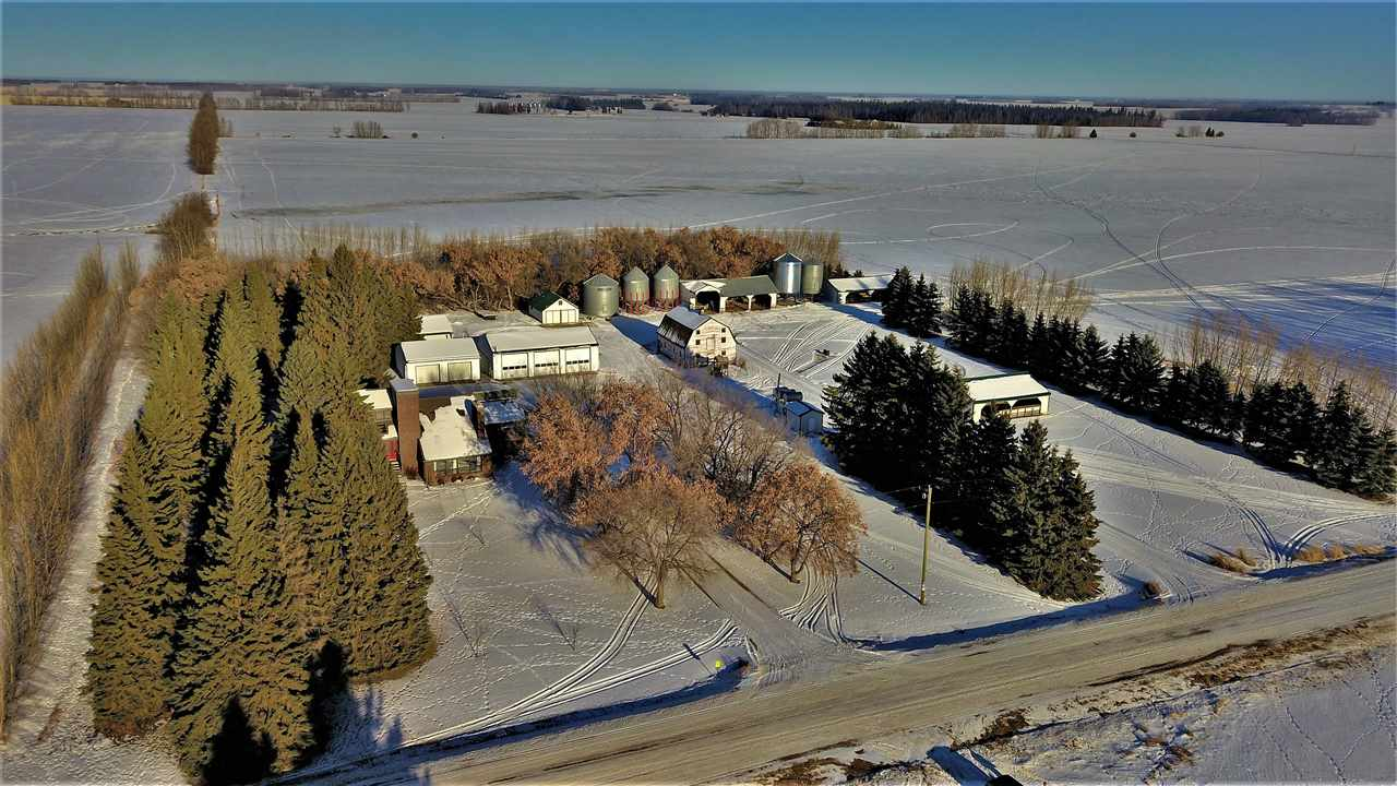 Farmer Wanted ? TURNKEY FARM comes complete with a FULL 1/4 SECTION of land (160acres) that has not yet be subdivided, with 10,000 SQ.FT. OF GARAGES, SHOP, BARNS AND OUT BUILDINGS. The HIGH PRODUCING LAND (mostly Grains & Canola) has been FAMILY OWNED SINCE 1930?S. Home has undergone MAJOR RENOVATION in the last few years and is literally STRAIGHT OUT OF MAGAZINE. Reno?s include, kitchen, bathrooms, windows, roof, furnaces, flooring, paint, and water well to name a few. PREPARE TO BE IMPRESSED - Endless open space and well planned out living throughout this CUSTOM BUILT FAMILY HOME. Everything has been METICULOUSLY CARED FOR and upgraded over the years including the YARD SITE THAT IS WRAPPED IN TREES. Located between Bon Accord and Legal and ONLY 20 MIN TO EDMONTON. Bussing available for schools to Bon Accord and Namao for senior high.  Property includes all appliances and A FLEXIBLE POSSESSION. Don?t miss this RARE OPPORTUNITY to find such a complete package! 5 START PROPERTY Must be seen in person.