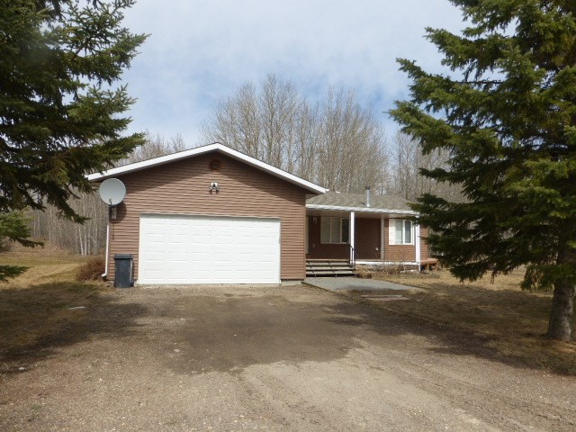This lovely 1587 sq. ft. three bedroom bungalow built in 2002 is located 2nd row at Sandholm Beach in the SV of Golden Days on the north side of Pigeon Lake.  This fantastic property has lake access and the ability to put a dock in.  The interior features a nice open concept with vaulted ceilings.  Loads of white cabinets in the large kitchen with corner pantry and centre island with storage and seating area.  Living room with laminate flooring and patio doors leading to the back deck.  Family room with cozy woodburning stove.  Three bedrooms with the master featuring double closets and 3 piece ensuite with walk in shower.  Four piece main bathroom.  Back entry has the laundry area with overhead cabinets and the utility area.  4?crawl space.  Double attached garage is heated.  Huge lot with loads of trees.  (102.16 x 82.15x 62.23.)   Shingles done in 2017 & siding in 2016. Municipal sewer.