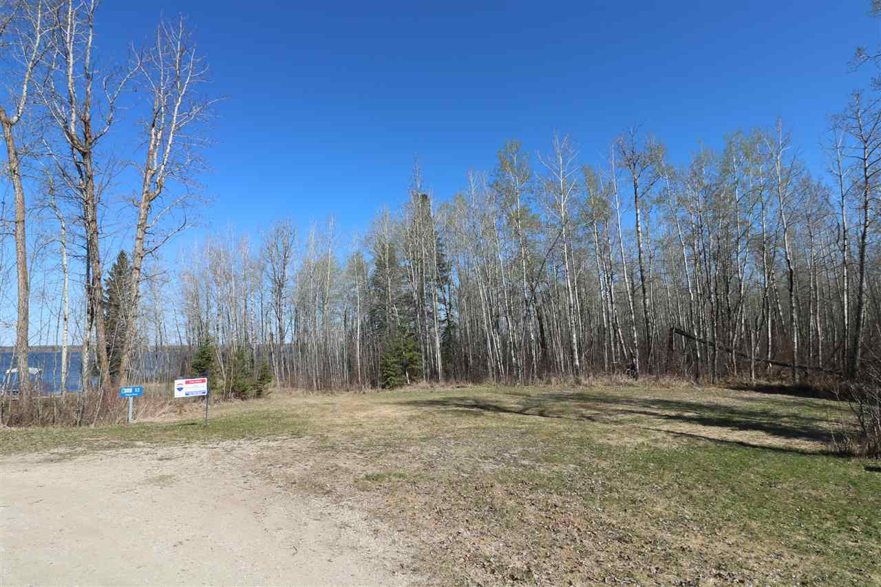 Fantastic get-away lot for you to build on or bring your RV and enjoy life at the lake! Almost as good as waterfront with lake views make this flat partially treed lot perfect. Easy access to the waterfront where you can put your boat lift and enjoy watersports. Easy paved commute west of the city and located in the Summer Village of Silver Sands. There is even a Golf Course right around the corner. Power and gas to the property line.