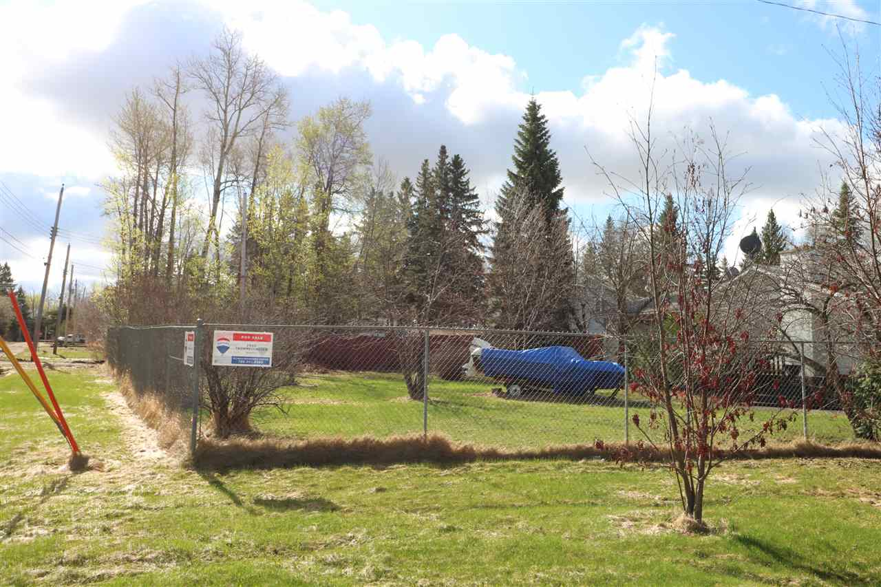 This Large corner Lot is located in a quiet neighbourhood in Alberta Beach. This lot is fenced on 3 sides as it was previously owned with the house next door. Beautifully landscaped with a variety of Fruit tress and Flowering trees and Bushes. Natural Gas and Power at the property line. Come and Build your Home or Cabin at the lake!!