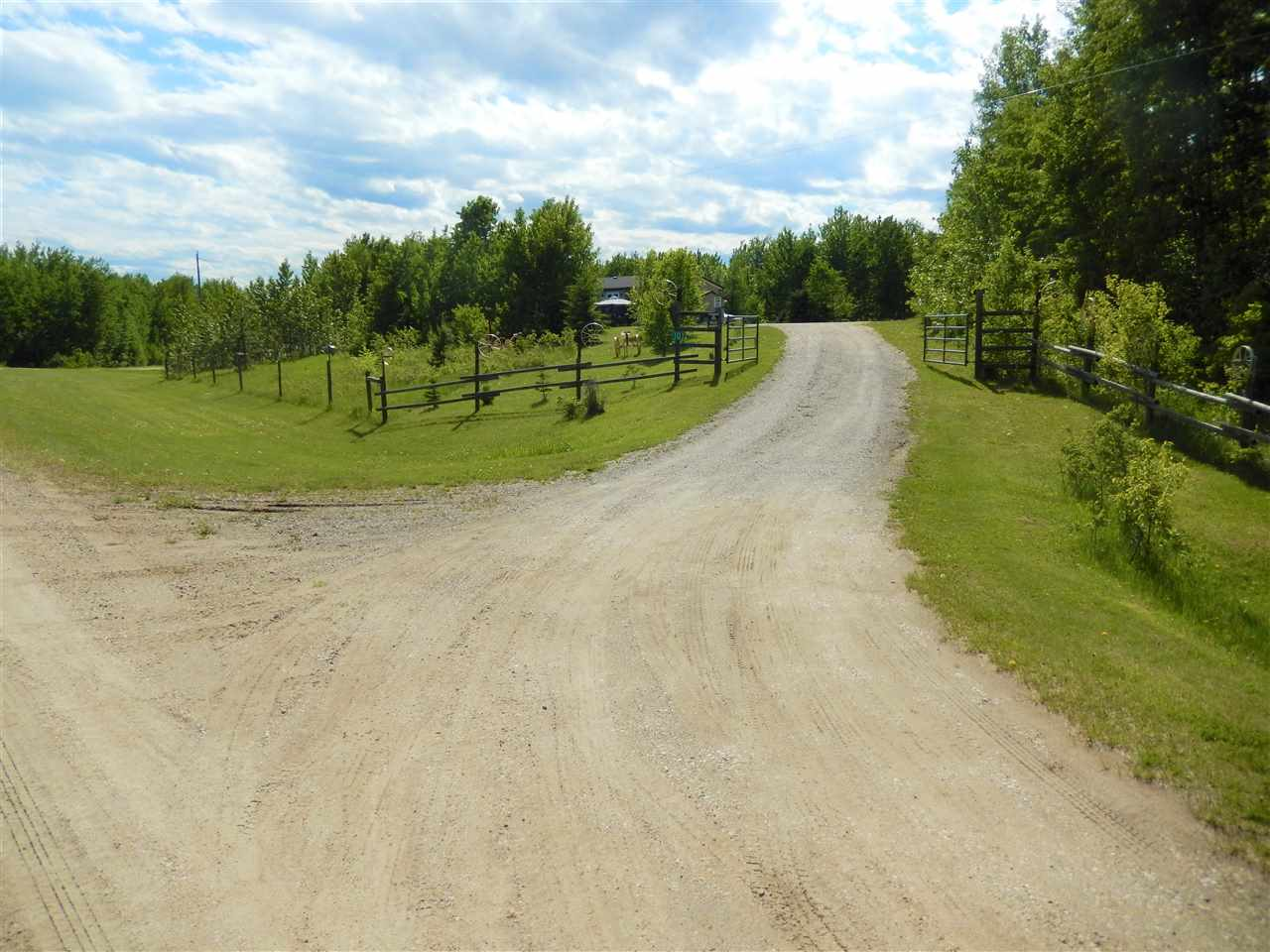 DREAM ACREAGE with EVERYTHING YOU NEED! 30 ACRES of FENCED, ROLLING TREED HILLS+TRAILS backing onto & facing CROWNLAND.  Beautiful 2007, 20 Wide Modular with LARGE FINISHED GARAGE/METAL ROOF, 220 power (24x30 ft deep w 10 ft ceilings) 2 OVERHEAD DOORS (one is 8x10 ft wide & one is 8x8 ft) + MAN DOOR. The home sits on CEMENT PILINGS & is TIED DOWN. Gorgeous layout with LARGE WORKING KITCHEN equipped with PANTRY, ISLAND, EATING BAR, newer STAINL appliances all opening up to big DINING AREA with BAY WINDOW next to the living rm. The MASTER is HUGE and has WALK-IN CLOSET & nice ENSUITE. Main door has plenty of rm for BOOTS/COATS & the LAUNDRY RM/STORAGE is right there. The CATHEDR CEILINGS run thru whole house & there is HIGH END LAMINATE thru-out except kitch, laund, foyer & bathrs. WORKSHOP is 20X10 with power. Also another 20x10 shed + 2 lean-to sheds & tent shed. GARDEN, 2 DECKS (one on E, one on W side), ROCK PATHS, CLOTHESLINE, GATED GRAVEL DRIVEWAY & GAZEBO finish it off!! Very well cared for!