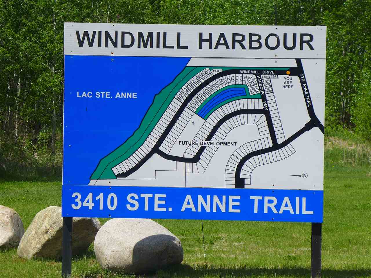 A SUPERB LOT IN THE GATED COMMUNITY OF WINDMILL HARBOUR ON THE SOUTHWEST SHORE OF LAC STE ANNE. Build your dream home near the water or have that weekend get-a way or just own a piece of Alberta. This is a very unique development with channels from the lake to the sub-division. This is a bareland condominium sub-division. Has community water/sewer.