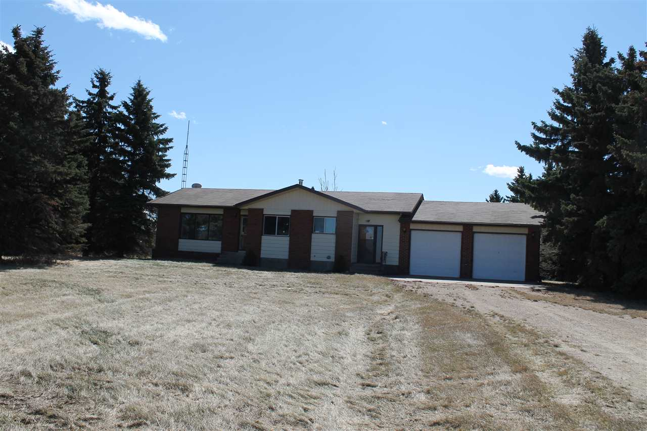 Opportunity Knocks with this great  4.4 Acre farm site with a recently upgraded 1400 Sq ft 3 bedroom bungalow with fresh paint and flooring , 2 car attached garage, Second garage ,  Barn, 32' x  60' Quonset , Tree lined land  with a highly visible  location on Highway 16 and Secondary 854    Proposed 4.4 acre subdivision , Government  road allowance driveway