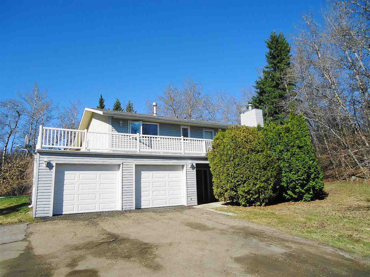 Beautifully treed & private lot on quiet cul-de-sac in desirable Hunters Hills only 13 minutes east of Sherwood Pk. Hillside bung with over 3000 sq ft developed. Huge balcony off LR wraps around north & east side of home. 3+1 bds & den. 3 baths. Massive living room with rustic woodburning fireplace with split log mantle. Formal DR with garden doors to deck. Eat-in country kitchen with solid wood cabinets. Massive MB with 4 pc ensuite. Basement has cozy FR, huge RR with built-in aquarium, spacious games area, bath, 4th bd & den. New engineered hardwood in 2014. New roof in May 2019. Vinyl windows in 2011. Eavestroughs replaced in 02. Premium sewage treatment plant in 2012. Home based business or mechanic's dream! Oversized dbl att garage + 52x30 SHOP built in 09 with 2- 8' overhead doors, heated office & storage + attached cold storage . 220V, radiant gas heat & numerous compressed air drops throughout. Ample quality shelving & cabinets included.  Aerated koi pond. Fish & winter tanks neg.