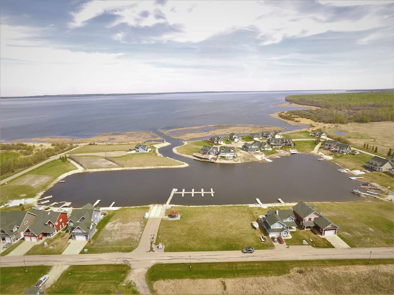 Welcome to Sunset Harbour! This Condo community is located on the West Tip of Pigeon Lake, with architectural design to meet and exceed your Expectations. Cape Cod Style Marina lifestyle with full access to Pigeon Lake that entertains full year around activities and Sport. Harbour Access and docking system as well as Municipal Water and Sewer, Paved Streets, all services to the Property Line. This lot is a South facing Large Pie shaped lot to enjoy full view of the Harbour. No Time limit to Build and applicable GST will apply.