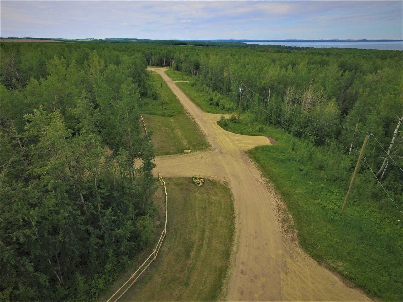 Looking for a Place to Kick back and build your dream Home? This 1.21 acre acreage is covered in Trees and has a Rolling Lot to accommodate a Walk-out Basement Home. Located close to Pigeon Lake for Recreation, Shopping and Golf Courses. Plus Applicable GST Several Lots and Prices to Choose.