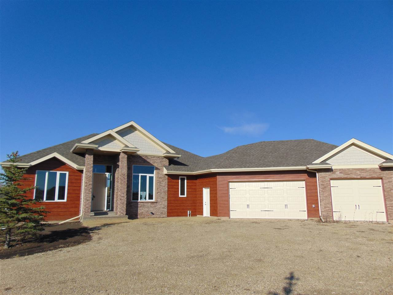 "FULLY FINISHED WALKOUT BUNGALOW with ""OVERSIZED"" TRIPLE ATTACHED HEATED GARAGE on 3.12 acres within minutes to the airport. 4 BEDROOMS, 3 BATHS, FORMAL DINING, 14' ceilings in living area and 9' ceiling in the rest of the house. Outstanding workmanship including, foundation wrapped in waterproof membrane, exterior cultured stone and NaturClad, large main floor deck, premium granite throughout with engineered hardwood and tile, natural stone f/p and custom built closets. The walkout basement provides lots of light, a wetbar, open area for the big screen, another bath, bedroom and office. This home has it all!! Come and take a peak. Shows awesome!!"