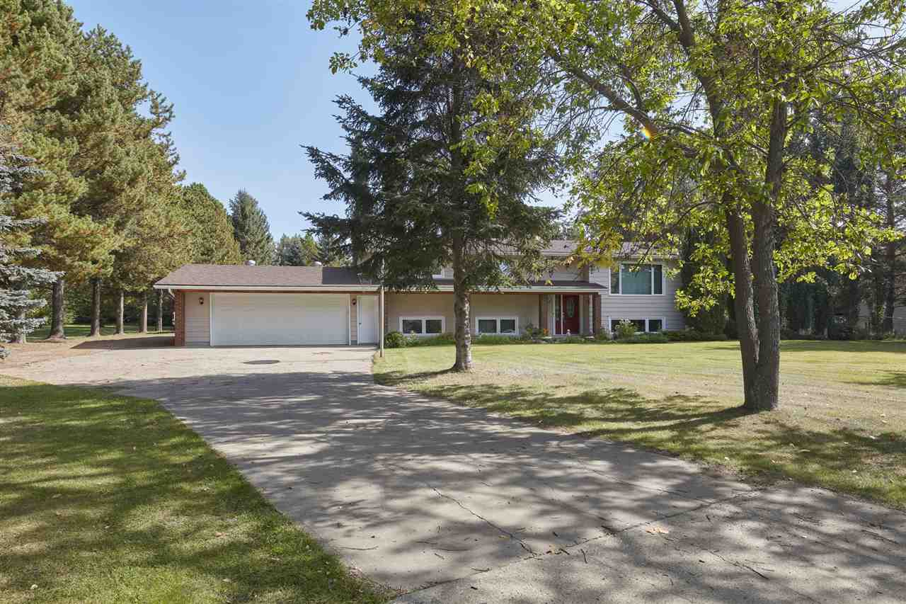 The perfect location in Summerbrook-2 km from St. Albert! This bi-level home has 1384sqft plus finished basement totaling 2603sqft of living space - 6 bedroom/3 bath - attached garage 25ftx25ft & SHOP 32ftx24ft (10ft door)(paved driveway) all situated on an 1.07 acre lot surrounded by treesEntering the home you will love the bright & open feeling. Step into the spacious living room with fireplace & continue on into the dining room. The spacious kitchen has ample counter & cabinet space. Down the hallway the master bedroom has a 3 piece ensuite. Bedrooms #2 & #3 are spacious & the 4 piece bath completes the main floor. Large windows bring natural light into the basement family room complete with fireplace & 3 add?l bedrooms. A 4 piece bath & laundry completes the basement. Step outside & enjoy the 2 tiered deck surrounded by nature! Recent upgrades include tile throughout, vinyl windows, shingles, HWT & paint. Easy access to major shopping and Edmonton and area!