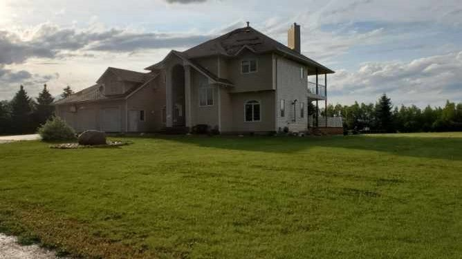 WOW! Over 3500 sq' 2 story a short walk from the banks of the N Sask River. Ideal home for large or extended family on 5.73 private acres out of subdivision. Well appointed home w/ stately curb appeal. Expansive exposed aggregate patio & custom stairs enter into spacious entry with 17' ceiling. Bright LR w/ gas stove & grand flex room flank either side of entry. Dream kitchen w/ solid oak cabinets featuring rounded corner units, massive island & huge 10.5' pantry. Large bright dinette w/ garden door to new wrap around cedar deck. Main floor FR w/ tile surround gas fp w/ bold oak mantel, french door & dry bar. Upstairs the tremendous owners suite overlooks entry through french doors & boasts 3rd gas fp, beautiful balcony overlooking deck & yard, 6 pc ensuite w/ his & her sinks, private water closet & corner swirlpool. 2nd bd has 3 pc ensuite perfect for nanny or inlaws. Jack & Jill 4 pc bath connects BDs 3 & 4. Bsmt is f-fin with huge RR, 2nd FR, bath & ample storage. Heated triple grg w/ 220v & water.