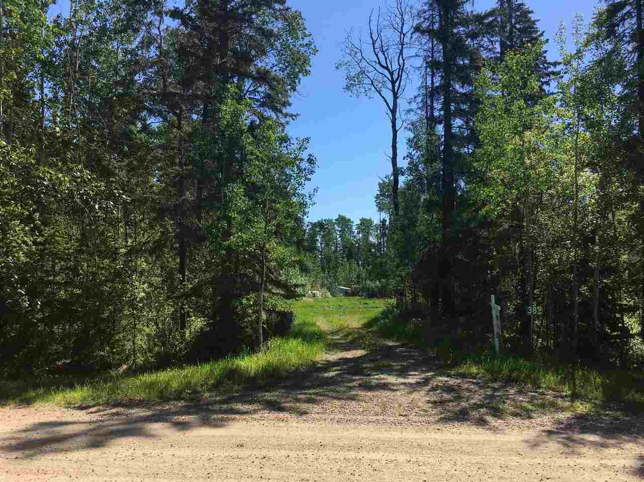 You will not find a prettier setting in this price range.  Period.  Tall trees, seclusion, backs on a walking trail AND onto a deep ravine leading to the North Saskatchewan river.  Not only is the setting picture perfect, there is a 24x40 cement pad already there, and the seller says the gas line, a 3300 concrete water cistern, a concrete 3300 sewage holding tank and 200 amp electrical are all underground in place.  The owner's house burned down a few years ago and they removed the concrete slab it was on.  Views of the river from one of the highest points along the North Saskatchewan are available just a short walk along the trail behind property.  Deer everywhere.  Approx 15 minutes SW of Stony Plain, and handy for those who work at Keephills & Genesse.