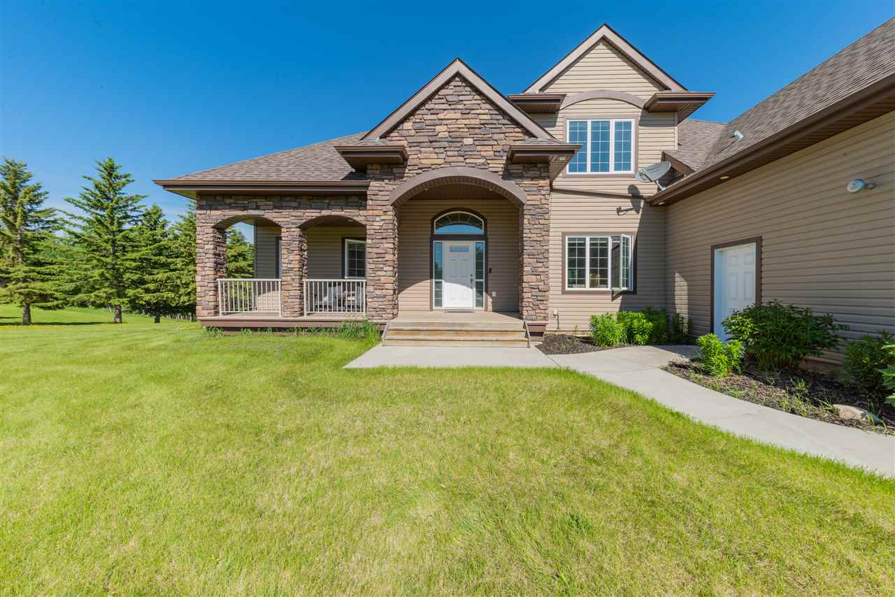 STUNNING and CUSTOM! This beautiful home has a perfectly finished walk out basement that backs onto a lake, with a pool to cool off and a full width rear deck to enjoy the sunsets! Located within a 25 min drive to WEM, 10 mins to Spruce Grove and easy highway access. Featuring 5 bedrooms, 3.5 bathrooms, 2 stone gas fireplaces, a wet bar, formal dining room, bonus room, an amazing family room and views over the lake from almost every room! The master suite has a gas fireplace, His/Her walk-ins and the ensuite shower has 2 shower heads and body sprays. An upscale kitchen with high end built in appliances, unique granite, wood cabinets, a big island, breakfast nook with a super functional coffee bar! There is an O/S, attached, heated 3 car garage that has in-floor heat with a floor drain. The house has radiant in-floor AND forced air heat, AC and loads of custom cabinetry. The walk-out basement has a huge rec room with french doors, and an open area that leads to the pool, hot tub and the manicured yard!