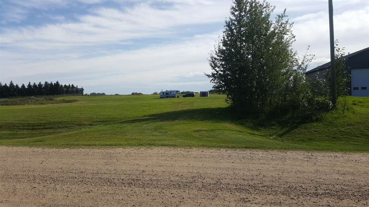 Today is your opportunity to enjoy your very own 2.55 acres in Luxurious Lamorra Landing Estates. This premium site includes all you need to build your dream home! In the meantime it is a sweet recreational property within walking distance of the North Saskatchewan River. Subdivision has already many upscale homes. Power, gas and phone line at the property line. Fantastic, quiet location, 20 min to Stony Plain.  Alfalfa and Timothy Hay currently growing. Shed, Lawn Mower, and Fifth wheel are on site.