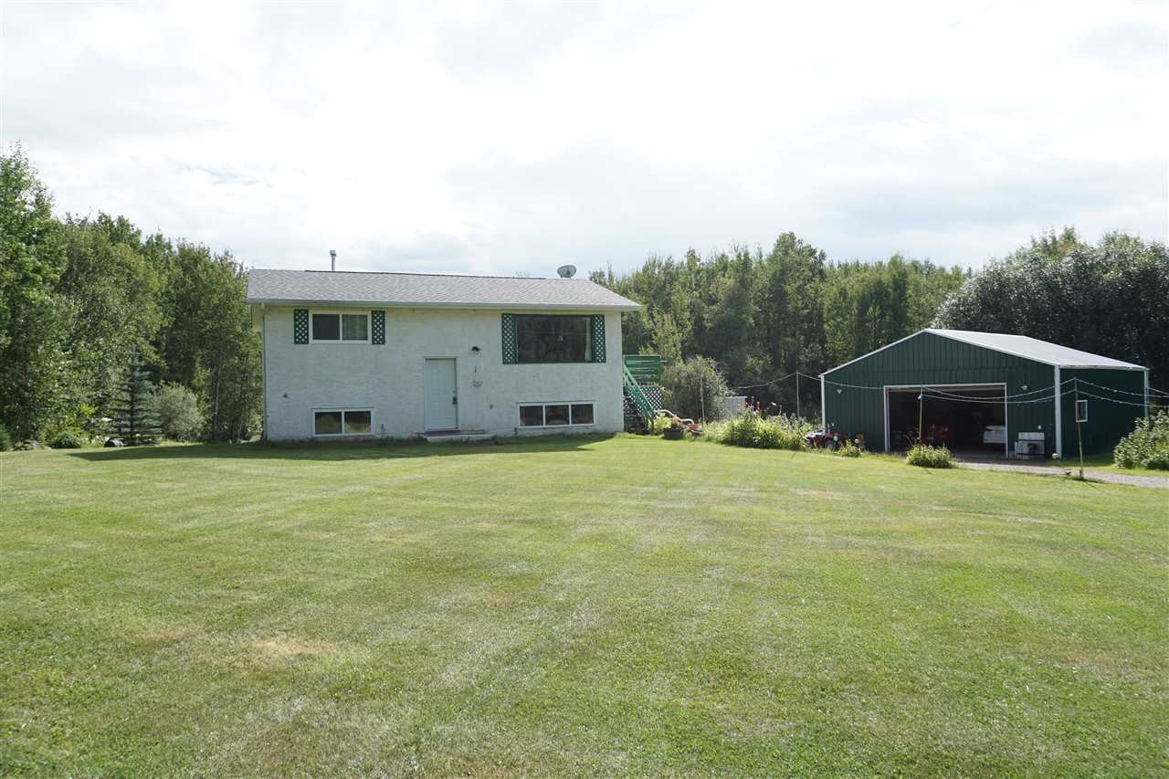 3.69 acres located in Golden Glen Estates with paved roads and just minutes away from Alberta Beach and Onoway. This great property features a 30? x 32? insulated shop with metal clad siding and in-floor heat. This country home is a 3-bedroom Bi-Level with a fully finished walkout basement with in-floor heat. The main floor has an open concept kitchen and dining area with ceramic tile and a living room with hardwood floors. Completing the main floor are 2 bedrooms with parquet flooring and a 4 pc. bath. The lower level has a 3rd bedroom, 3 pc. bath, laundry/utility room and a large open family room with large windows and an abundance of natural light. Mature spruce and poplar trees surround the property. Other features are 2 sheds for storage, a lean-to shed attached to the house with a deck above, large raspberry bush area and a drilled well.