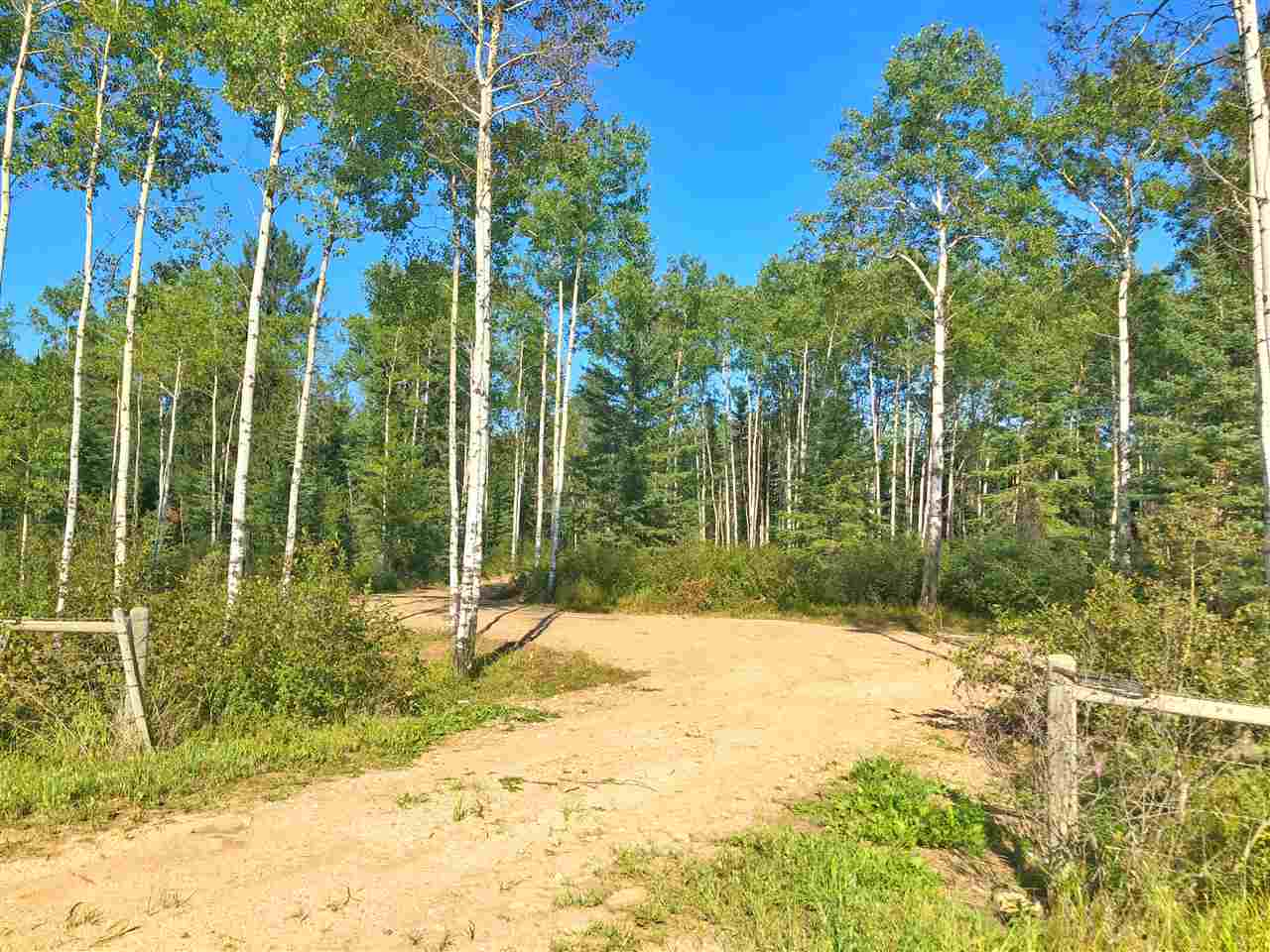 4.99 acres West-Hwy 55! Centrally located 5 minutes to Cold Lake you will find this perfect private oasis.   Enter the approach that leads you into a cleared area that is completely surrounded by poplar, spruce and jack pine.  Expand the clearing for more space or keep it as dense as you want with trees.  Don't step on the wild blueberry bushes covering the ground everywhere!  Power is on the property with gas at the property line.  Maximum privacy with lots of space and did I mention - Location Location Location! If you have been waiting for that perfect acreage HERE IT IS!