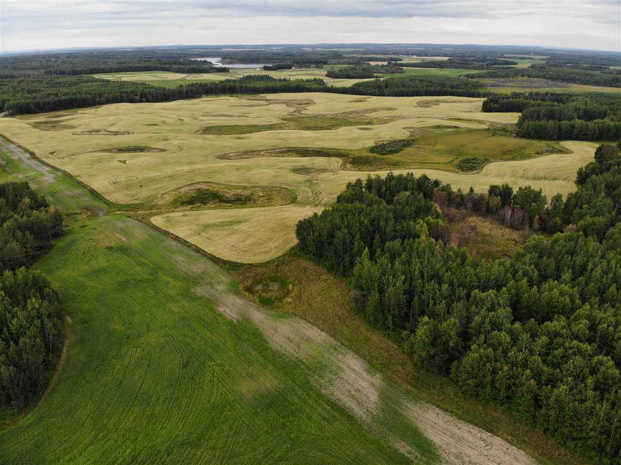 "1243 Acres of Deeded Crop, Hay and Pasture Government Lease Land West and North of Barrhead situated in one connected block and backing onto well over 100 quarters of Undisturbed Crown Land. 605 Acres deeded & 640 Lease. (SE of 5: 160 acres total, 100 acres open, Canola, Oats & Wheat Rotation) (NE of 32: 160 acres total, 65 Acres, Canola, Oats & Wheat Rotation) (SW of 4: 160 acres total, 75 acres open, Hay & Oats) (SE of 4: 160 acres total Natural Pasture, Surface Lease $1875 per/ year) Property features water sources throughout w/ Lease including Year round natural Lake water source. Good cut Lines and Fence lines conveniently cleared 30'-40' w/ fresh grass seeded. Exterior of entire lease fenced w/ lifetime 3"" solid plastic posts. Outside 5 wire, cross fencing 4 wire. High grass producer through dry times. Bonus Exceptional Wildlife Presence and Activity, Trails, Private singular dead end road access, Water sources, Surface lease Revenue and more."