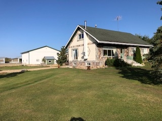 This is one loaded 8 acre property with a roomy 1922 sq ft 7 bedroom 4 bathroom house with a brand new roof, a 22 by 20 deck on the west side, a very new 50 ft by 50 ft heated shop with 18 ft walls, water, a 35000 watt portable PTO generator,one 16 ft door , One 14 ft door and one 8 ft door. There is a insulated milking parlor 50ft by 80 ft with 10 ft+- ceiling attached to a huge loafing barn 80 ft by 122 ft with 12 ft openings. Also has a pole shed 25 ft by 60 ft that is 16 ft high and a 24 by 100 ft open shed. There is one large loafing barn 80 X 100 that will be removed before completion of the sale. There are 3 wells, the sewer has just been upgraded to a new mound, lots of fence and pasture for some livestock. Even a 16 by 24 chicken coop! So much more to see!! All of this and only 3 miles north of Barrhead on paved Hwy 769. The subdivision is conditionally approved.