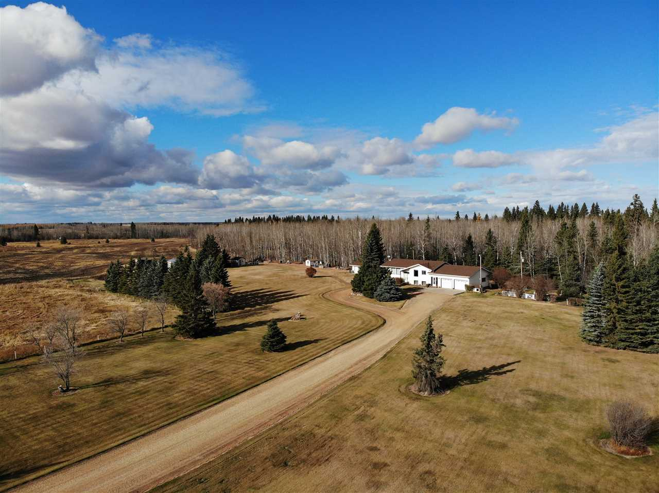 Fantastic 145 acre Farm only 6 miles West of Barrhead featuring very well built & proudly kept one owner Home and yard site. Unbelievable natural state w/ approximately 30 acres cultivatable & 110 acres mature spruce & poplar bush full of winding trails & wildlife. Clean & neat 1978 1536sq ft 3+ bedroom, 2 full bath Bi Level features ahead of it's time open concept floor plan, extensive kitchen cabinetry, spacious dining & large light filled living room. New high efficiency furnace & HW tank. Bsmnt full of recreation area, large windows & Wood stove. 24x30 high wall attached heated Garage. Bonus detached 24x26 heated Workshop Garage. Corrals & livestock shelter. 2 chicken coops. Perimeter & cross fencing. 2 drilled Water wells. 1 for home, 1 for livestock. Meticulously kept yard site full of healthy spruce & ornamental trees. Rich & fertile sheltered Garden plot. Back meadows & camping area. Much much more to see & feel for yourself.