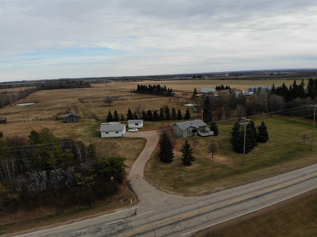 Gorgeous & increasingly rare find for a parcel size of 20 acres w/ modernized & attractive 4 bdrm, 2 bath, Main flr Laundry Bungalow w/ fully finished bsmnt located under 10 min NE of Barrhead along hwy 769. Home features opened concept design, plentiful bright kitchen cabinetry, quality appliances, excellent large living room w/ fireplace, award worthy restyled main Bath plus great bsmnt family area large enough for pool table, cold room, updated utilities & more. 2 full size front & back sitting decks. Over-sized 26x28 heated Garage/ Shop, R.V Pad parking plus extra quality storage Building. Sprawling well presented landscaping includes Apple & Pear orchard, fire pit area, mature spruce, great garden plot plus more to see in person. Land delivers cross fencing, 2 good dug outs, multiple watering bowls, corrals, extensive pasture & livestock support. A property proudly owned, meticulously kept & continuously updated ready & awaiting you for an active worry free future of enjoyment & unbridled imagination