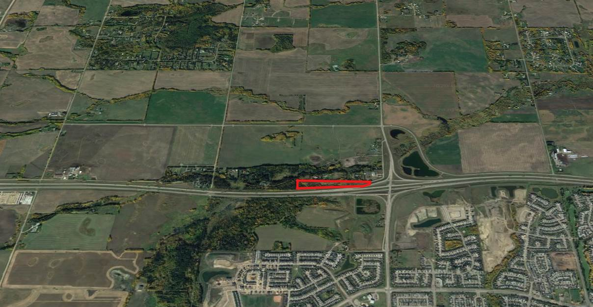This 11.31 acres is predominately all treed, it's located at the end of a dead end road and sides directly onto the Yellowhead Highway. It's located 1 block West of the Jennifer Heil Way turn off into Spruce Grove. Endless possibilities and the price is amazing. Show and Sell with Confidence.