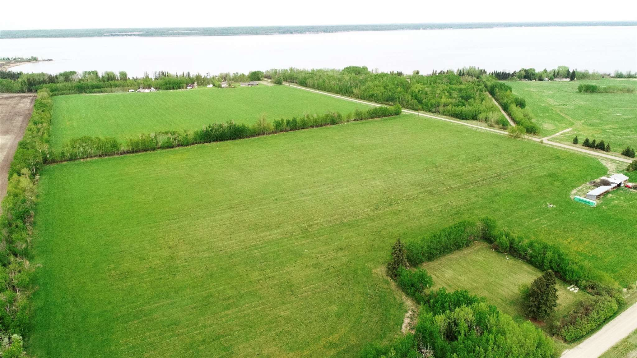 Great 31.425 acre piece mostly all cleared and on pavement and close to the lake. Out of subdivision and Currently being used for crop.  Partially fenced and old machine shed on the property. Just minutes from Alberta Beach. Come build your dream home, hobby farm or perhaps Home based business. Located in between Lac Ste Anne and Hwy 633 just off Range Road 40.