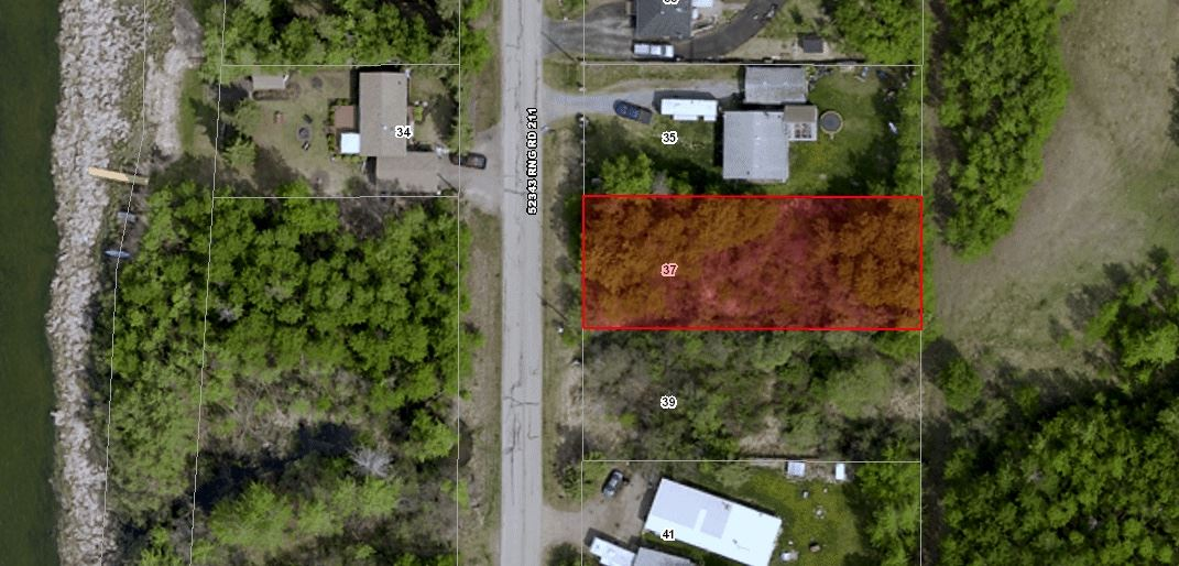 Treed .275 acre lot across from lakefront. Treed reserve with lake access across street. Municipal water and sewer available. Lake view from future second floor balcony. Super buy for this rare find.