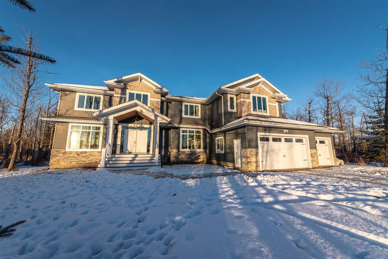 CUSTOM BUILT 8 BEDROOM LUXURY HOME FOR LARGE OR MULTI-GENERATIONAL FAMILIES on 1.4 acres in sought after Atim Creek located just minutes to Spruce Grove.  The main floor has many windows and offers a large foyer, livingroom, dining room, great room (kitchen/eating area/family room) with gorgeous stone fireplace (2 way to the covered deck)  and built in entertainment wall, huge pantry, office/den, master bedroom with walk in closet and ensuite, mud room, and 2 half baths.  Upstairs there are 5 large bedrooms, 2 full bathrooms uniquely designed with water closet toilet and tubs for maximum efficiency and a massive bonus room!  The finished basement offers a cozy family room with fireplace and wet bar, 2 bedrooms with adjoining bathroom, a sound proof rec room/gym/studio/craft area plus a large laundry room and half bath.  Outside is a gorgeous covered deck, a stone patio area in the very private yard backing trees. Triple garage/RV parking. THIS HOME IS THE PERFECT BLEND OF LUXURY AND EFFICIENT DESIGN!