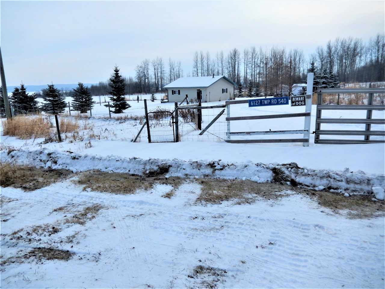 This 23.5 ACRE parcel has a 2006 BUNGALOW with CATHEDRAL CEILINGS, OPEN CONCEPT, WOOD STOVE, PATIO DOORS, DECK, 1 BEDR & a BATHR (which still needs plumbing etc) & SHED (8x10) The home was built on a CONCRETE SLAB, but has no plumbing yet and the gas line is at the property line. The ELECTRICAL is complete. There are 3-220 amp breakers.  There is an OUTHOUSE with a 750 GAL. HOLDING TANK and there is an outlet to allow connection to the house as well. The LAND is mostly open & the Seller has it HAYED every year. The perimeter is FENCED & GATED and the immediate yard is FENCED & GATED.  The property sits at the end of a DEAD END road and has a neighbor on one side.  One side of the property borders HWY 633 & is only minutes to LAKE ISLE. What a great place to GETAWAY to or create a YEAR ROUND HOME & raise ANIMALS.  Only 2 km of gravel to the property & its 14 km to Darwell & 15 min to Seba Beach.