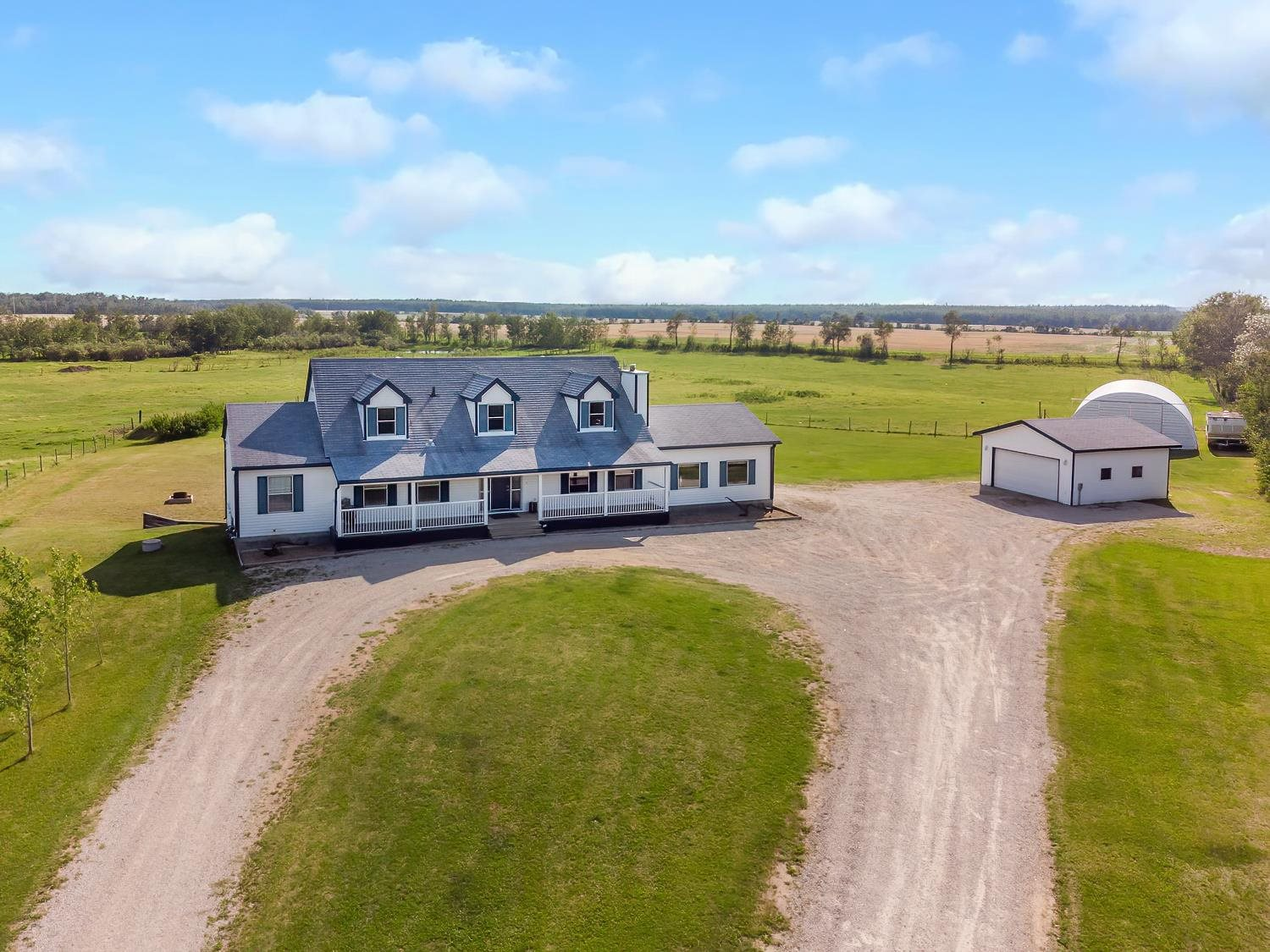 Amazing opportunity! This 8.84 acreage is located just minutes from Cold Lake and the back gate access to 4 Wing.  If you are looking for a peaceful country setting without the drive THIS IS THE ONE FOR YOU! It features attached heated double garage, double detached garage and 30x40 Quonset. This home has 6 bedrooms, 3 full bathrooms and 2 half baths offering space for everyone in the family. Whether you are curled up in front of the wood burning fireplace or sitting on the spacious front porch, the views are breathtaking. Over 2500sq feet on the main levels. Main floor offers Master with walk in closets and ensuite bath, bright large kitchen with island and roomy living and dinning room. 2 more bedrooms and 2 bathrooms finishes off the first floor. The upper level to this home is charming with it's large window dormers. 1 bedroom and 1 bath with a bonus living area. Let's not forget the extra 1800sq feet of finished space with in floor heating, 2 bedrooms,1 bath, Rec Room with bar and walk out basement.