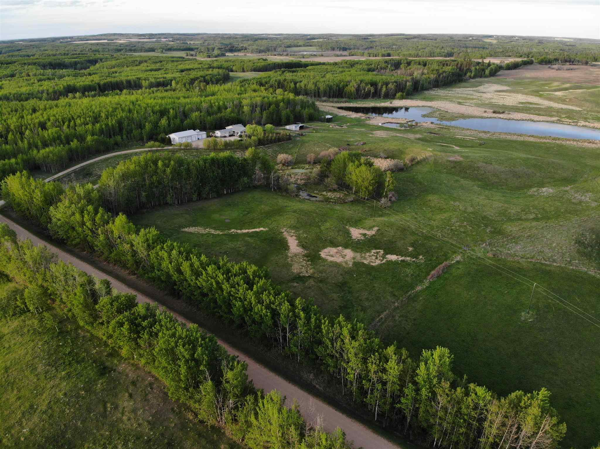 Remarkably Special 79 acre property rich with Features, Gorgeous landscape, Spotless 2120 sq ft Home, Modern 34'x50' high wall Shop w/ oversized attached 28'x32' Double Garage at side for convenient parking & much more. Incredibly cared for Home features 3 nice size bedrooms plus optional large hobby room or 4th bedroom. 2 full bath. Excellent country entrance & convenient central laundry. Sprawling family room full of bright natural light & corner wood stove. Extensive bright white kitchen cabinetry complete with full set of stainless steel appliances, open attaching dining room & access to outside bbq deck.  Unbelievable south facing covered entertainment deck. Fresh exterior stucco plus many other high quality improvements. 14'x50' covered R.V. Storage. Multitudes of pipe steel corrals, 12'x30' Livestock Barn along with 18'x30' Cattle Shed. High & dry yard site. Winter skating area. Presence, productivity and unbridled continued potential wrapped into a country package ready and waiting you.