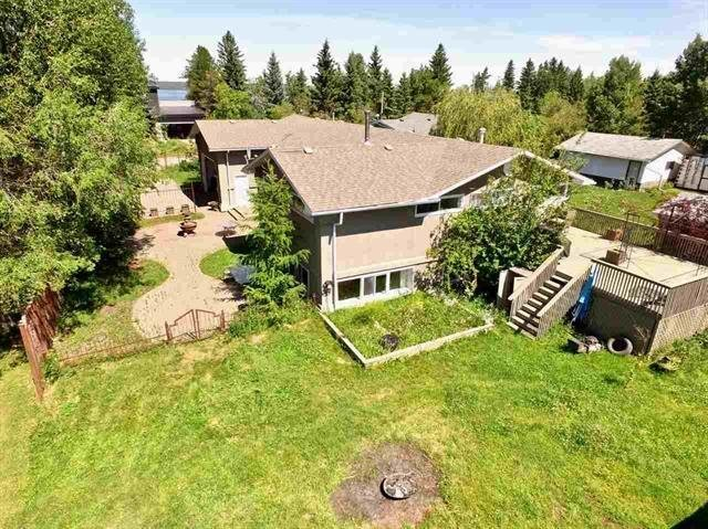 This LAVISH 1927.94 sq. ft. lakeside home has 7 bedrooms plus an additional 1840 sq. ft. of finished walk-out basement with separate entrance. The main level highlights the gleaming hardwood floors in the the dining, living, area accenting the beautiful wood fireplace (w) stone features & log storage. The main floor plan has 4 spacious bedrooms. The large master bedroom has a sitting area, walk-in closet, and en-suite with steam shower. The stylish kitchen flows through to the dining area and has ample cupboards & counter tops. The bottom level offers a stellar recreation room with kitchenette & cold storage plus 3 additional bedrooms and bathroom. Enjoy the sunsets & privacy from the 20' x 23' rear deck. The property is gated and includes a cobblestone driveway, courtyard and double attached heated garage.  This property backs on to environmental reserve. There is community lake access and and pier. Extras: Water & double sink in 24'X40' garage with 10'X20' door (w) 14' ceiling, water treatment system.