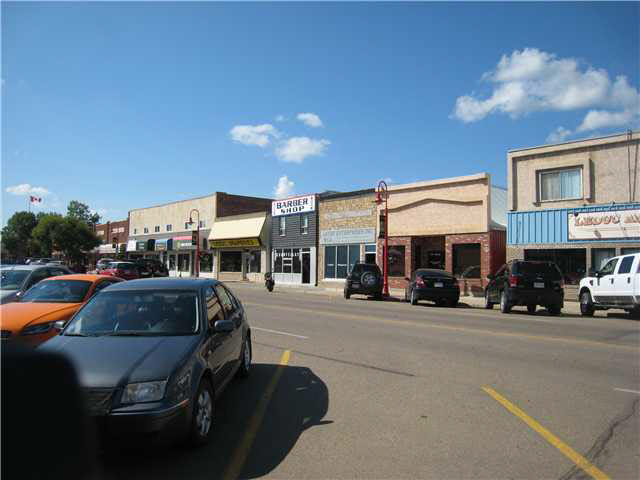 Unique property combination of retail and 3 apartments, plus vacant lot on separate title. Located on main street Leduc. Good investment property with tenants in all units. Or ideal for retail space and with living accomodations.