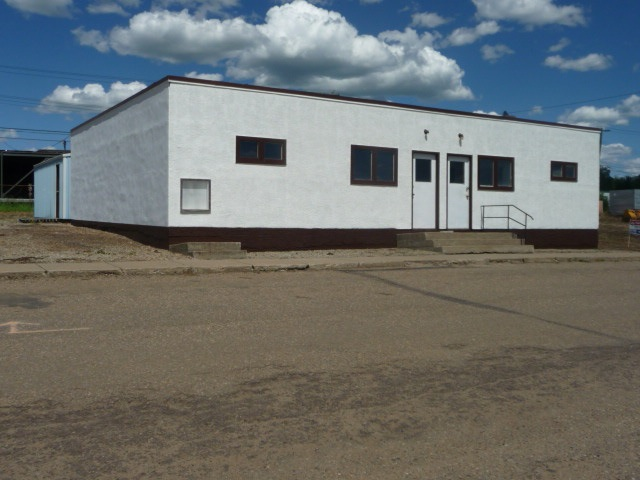 Clean Commercial Land and Building zoned C-2 with several permitted and discretionary uses being available.   Located in the South East area of Two Hills on 47th avenue with a land base of 18,200 sq.ft.  The main shop contains an 1112 sq.ft. concrete building with full concrete building with full concrete floor, newly painted exterior, new concrete drive aprons, and a new professionally installed SBS roof system installed in August 2014 ($19,425.00) plus a 22 x 24 all metal shed with double steel doors on a concrete floor, a 22 x 22 all metal shed with double steel doors on a concrete floor and an 18 x 20 wood frame shed with new shingles.  Great investment opportunity; one complete package priced to sell.
