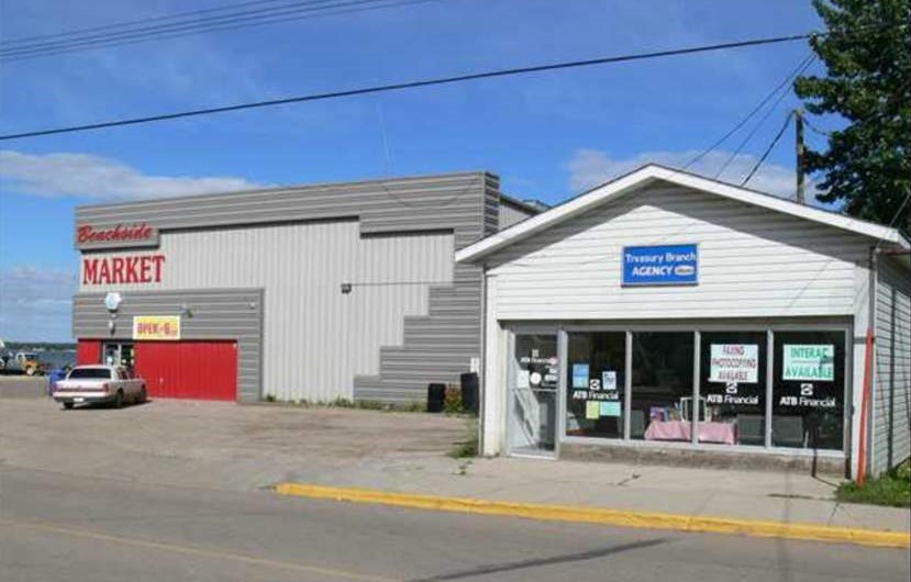 Excellent opportunity in Alberta Beach. LAKEFRONT PROPERTY  located on main street right beside the pier and the public beach. Huge lot with 2 buildings including a 5200 + sqft 2 storey building which is leased by a well established grocery store (3 years remaining on lease) TRIPLE NET LEASE and potential CAP 8.5%+. PLUS there is room to grow the income on the upper level which currently contains one 1000 sqft fully developed apartment suite featuring lakefront views, 2 bedrooms and a private entrance. Best part there is room for 3 more apartments in the future! The second building (about 800 sqft) is also leased (by an Agent of Alberta Treasury Branch). Located less than 60 kms West of Edmonton. the Village of Alberta Beach is a popular destination on beautiful Lac ste Anne where the population swells from 900 to over 3000 during summer weekends.